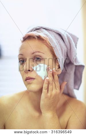 Cream On Her Face, Mask On The Face, Problem Skin - Girl Applying Facial Mask.