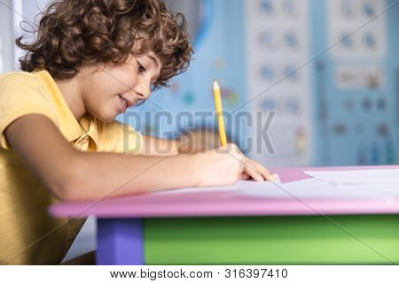Cheerful Kid Having Fun In Playroom Stock Photo