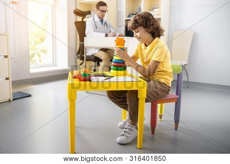 Cheerful Boy Playing With Toys In Hospital Stock Photo
