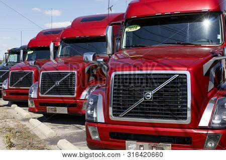 Ft. Wayne - Circa August 2019: Volvo Semi Tractor Trailer Trucks Lined Up For Sale. Volvo Is One Of