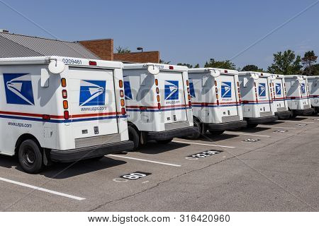 Indianapolis - Circa August 2019: Usps Post Office Mail Trucks. The Post Office Is Responsible For P
