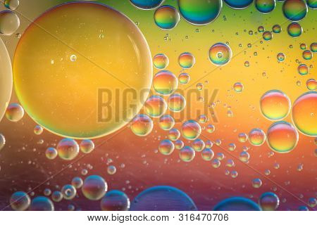 Oil Drops In Water. Abstract Psychedelic Pattern Image Rainbow Colored. Abstract Background With Col