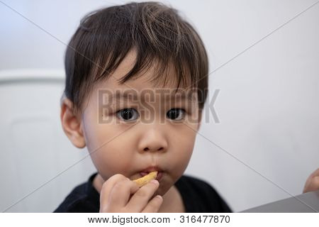 Children Are Sitting To Eat French Fries At Restaurants.
