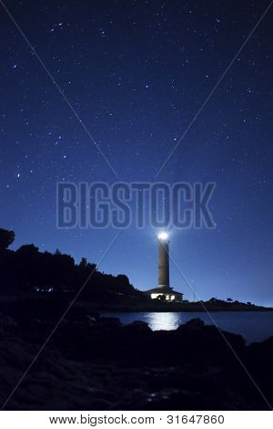 Lighthouse And Stars At Night