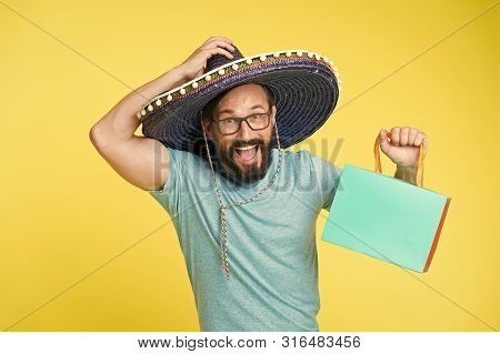 Buy Souvenir From Travel. Man Wear Sombrero Hat Shopping Yellow Background. Guy With Beard Happy In