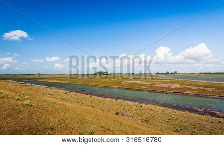 Colorful Landscape On The Former Dutch Island Of Schouwen-duiveland. The Photo Was Taken On A Sunny