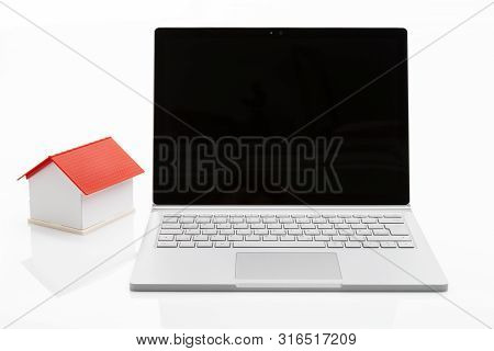 Image Shows A Laptop With A House Isolated On White