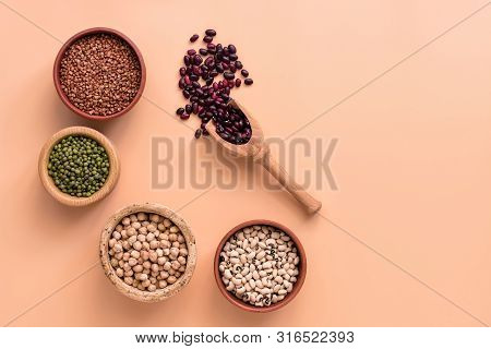 Healthy Food, Bowls A Variety Of Legumes, Red And White Beans, Chickpeas, Buckwheat, Mung Beans On P