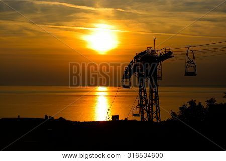 Silhouette Of The Cable Car At The Needles In The Isle Of Wight At Sunset