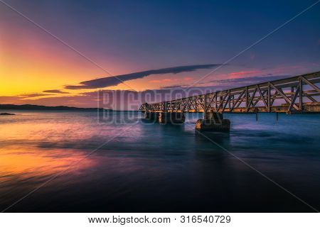 Pier In The Port Of Luderitz At Sunset. Luderitz Is A Harbour Town In The Karas Region Of Southern N