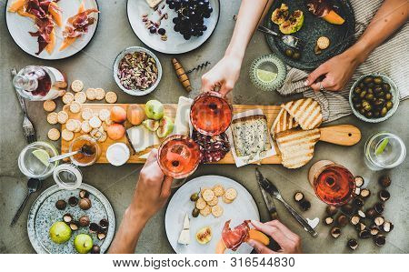 Charcuterie And Cheese Board, Rose Wine, Snacks And Peoples Hands
