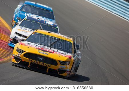 August 04, 2019 - Watkins Glen , New York, USA: Clint Bowyer (14) battles for position during the Go Bowling at The Glen at Watkins Glen International in Watkins Glen , New York.