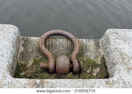 Shackle for ship attachment on the shore, pier - detail shot poster