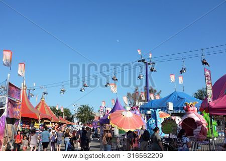 COSTA MESA, CALIFORNIA - AUG 8, 2019: The Sky Lift Ride at the Orange County Fair takes visitors over the crowd.