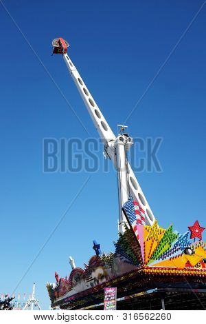 COSTA MESA, CALIFORNIA - AUG 8, 2019: Thrill Ride at the Orange County Fair, just one of the many attractions at the annual event.