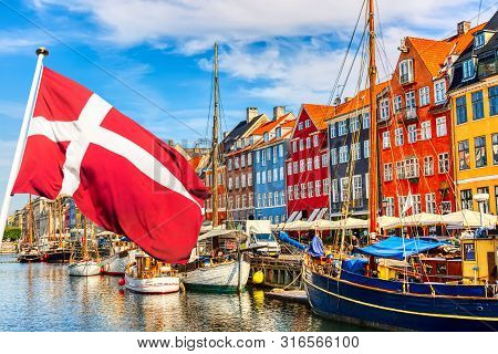 Copenhagen Iconic View. Famous Old Nyhavn Port In The Center Of Copenhagen, Denmark During Summer Su