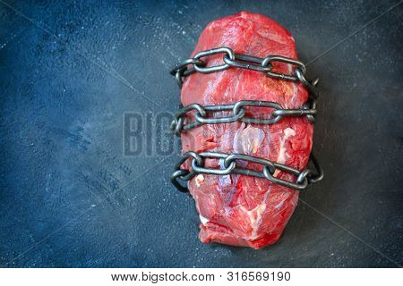 Vegetarianism. Vegan Food Concept With No Meat. Piece Of Meat Coiled With Chain. No Animals Products