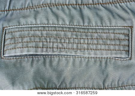 Gray Fabric Texture Of A Piece Of Cotton Clothing With A Seam And Pocket