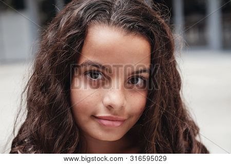 Close Up Portrait Of A Confident, Charming And Gorgeous Mixed Multicultural Preteen Girl With Beauti