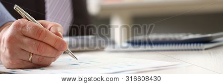 Booker Accomplish Corporate Annual Budget Stats. Businessman Calculate Expenses And Profit Using Pen