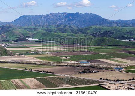 Aerial view of Camarillo farm fields and Mt Boney Wilderness area in scenic Ventura County, California.