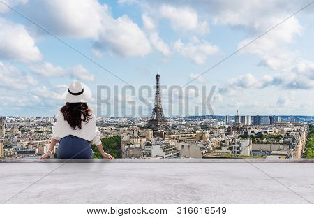 Young Traveler Woman In White Hat Looking At Eiffel Tower, Famous Landmark And Travel Destination In