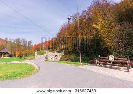 Beautiful Park In The Mountains. Wonderful Sunny Autumn Weather. Trees In Fall Foliage. Lanterns And