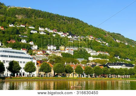 Beautiful Landscape With Floyen Mountain, Colorful Houses And Lille Lungegardsvannet Or Smalungeren