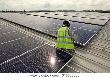 Technician Connecting Cable Of The Solar Pv Rooftop System