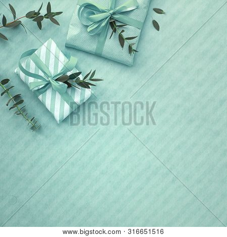 Flat Lay In Light Green Hues With Wrapped Gift Boxes Decorated With Eucalyptus Twigs. Flat Lay, Corn