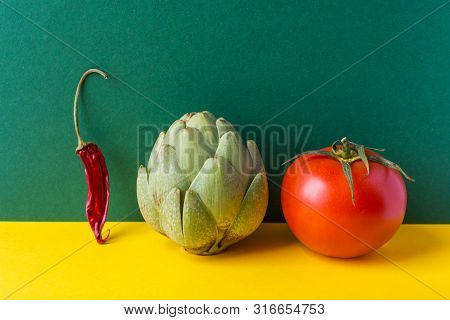 Artichoke Ripe Juicy Tomato Hot Chili Pepper On Duotone Yellow Green Background. Creative Food Poste