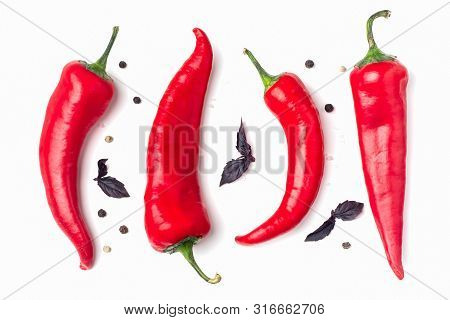 Red Hot Chili Peppers On A White Background. Hot Spicy Spices For Cooking: Chili Pepper, Garlic, Bas