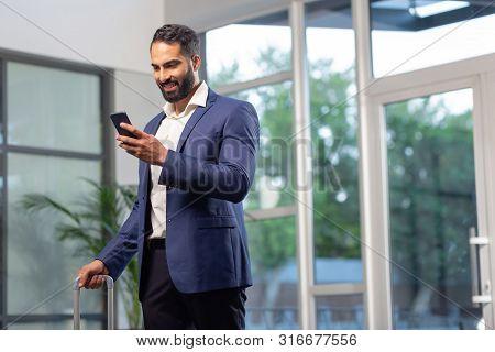 Cheerful Bearded Office Worker Having Business Trip