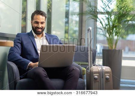 Positive Delighted Brunette Male Person Reading News