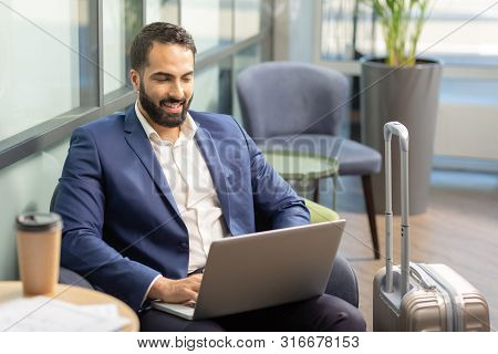 Positive Delighted Business Owner Being In Business Trip