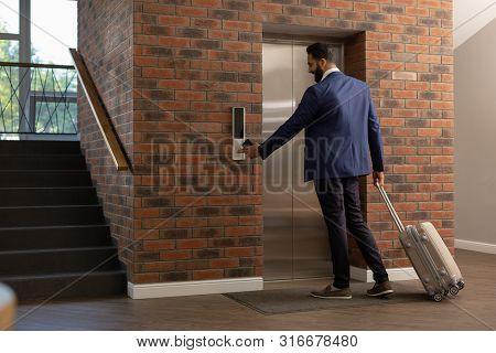 Handsome Brunette Businessman Having Mission In New City