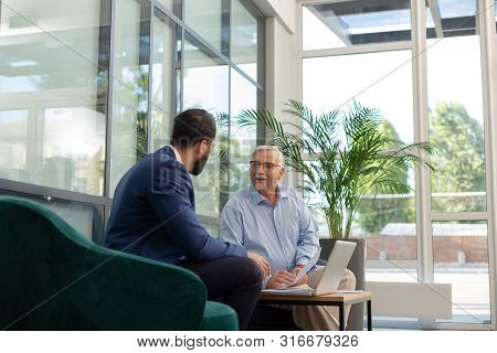 Cheerful Grey-haired Man Consulting With Progressive Businessman