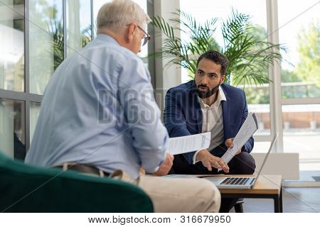 Attentive Brunette Office Worker Talking To His Partner