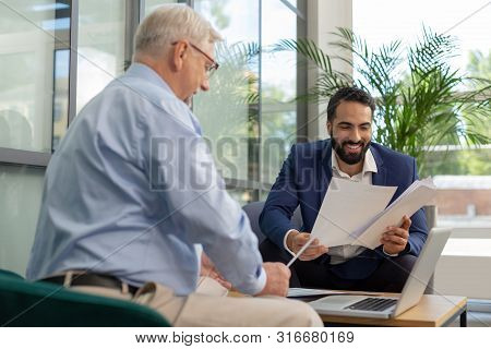 Positive Delighted Men Working Together In Business Center