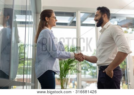 Cheerful Bearded Male Person Welcoming New Worker