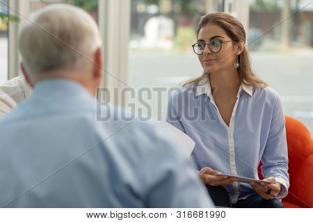 Cute Young Woman Being On Business Meeting