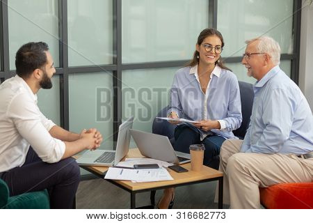 Young Female Person Listening To Her Colleagues