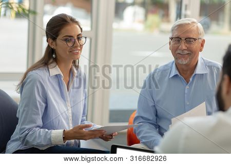 Delighted Young Office Worker Presenting Her Business Idea