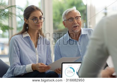 Charming Brunette Longhaired Female Person Holding Documents