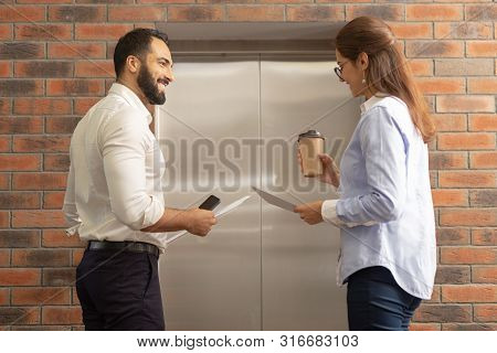 Delighted Brunette Man Flirting With His Colleague
