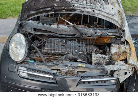 Burnt Car After A Fire, Body Parts Burnt Door Handles And Cracked Glass, The Picture Is Not Pleasant