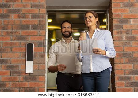 Positive Delighted Young People Going To Their Workplace