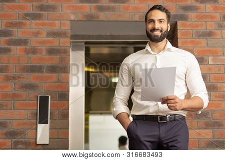 Cheerful Bearded Male Person Looking For His Colleagues
