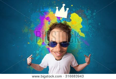 Funny person with big head and drawn crown