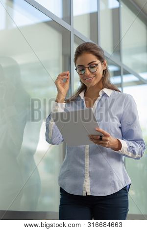 Positive Delighted Young Woman Preparing For Meeting